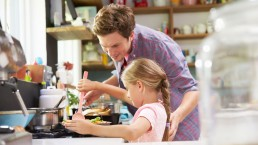 Girl and dad making family dinner together Q Wunder