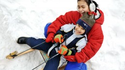 Q Wunder bond with your kids sledding holidays